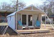 Tenthuis op camping beconcurreert hotel