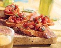 Crostini met tomaat en garnalen